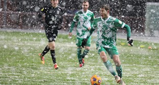 Players of the FC Akhmat Grozny (in a green uniform). Photo by the press service of the FC http://fc-akhmat.ru