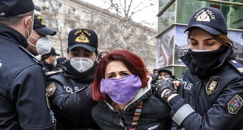 "The police detains the participant of a feminist rally in Baku, March 8, 2021. Photo by Aziz Karimov for the ""Caucasian Knot"""